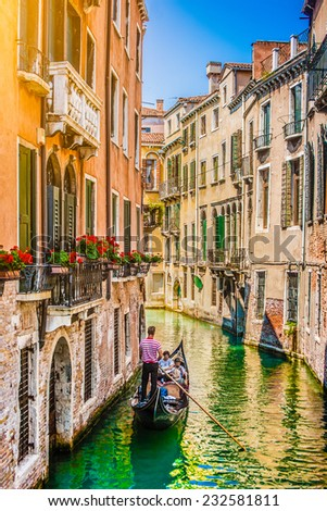 Beautiful scene with traditional gondola and canal in Venice, Italy #232581811