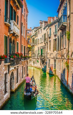 Beautiful scene with traditional gondola and canal in Venice, Italy #328970564