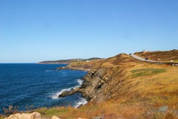 Beautiful scenery around Inverness  in Cape Breton, Nova Scotia along the Cabot Trail and its winding roads on the Atlantic Ocean in Maritime Canada during the Autumn or Fall season
