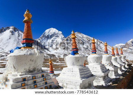 Beautiful scenery North face of sacred Kailash mountain covered with snow with group of white tibetan chortens(pagoda) in foreground and clear blue sky in background,Tibet,China