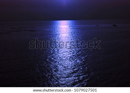 beautiful scenery of reflection in purple color on ripple sea surface in minimal and dramatic style so awesome fantasy pattern for abstract nature background