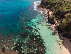 Beautiful scenic aerial landscape of rocky shores, beaches, tide pools and cliffs.  Aquamarine ocean water and sunny day