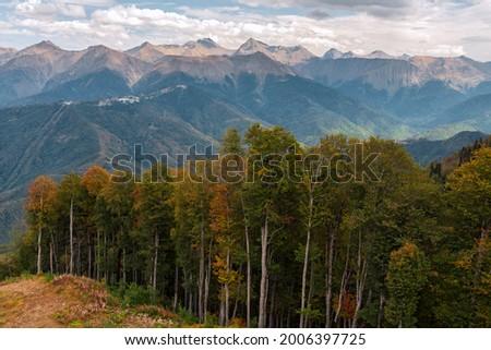 Beautiful scenic autumn landscape of Caucasus mountain peaks and forest in Krasnaya Polyana mountain resort, Sochi, Russia. Main Caucasus Ridge