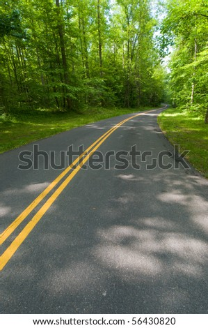 Beautiful scenic country road curves through Great Smoky Mountain National Park. - stock photo
