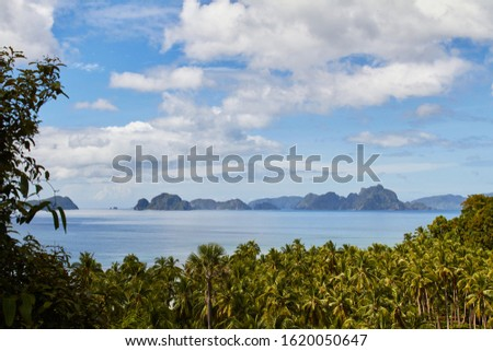 Beautiful scenic marine tropical landscape. Sea and waves, rocky cliffs, mountains. In El Nido. Palawan. Philippines