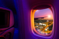 Beautiful scenic night city view through the aircraft window. Image save-path for window of airplane.