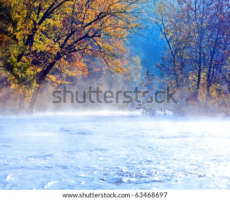 Beautiful scenic river in fall with early morning mist
