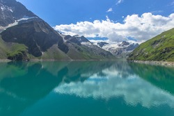 Beautiful scenic view of high mountain lake near Kaprun.Hike to the Mooserboden dam in Austrian Alps.Quiet relaxation in nature.Wonderful nature landscape,turquoise tranquil water,holiday travel scene