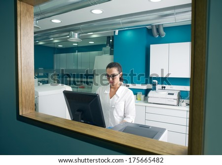 Beautiful scientist working on the computer in a modern lab