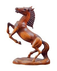 Beautiful sculpture of horse made of only one peace of wood isolated on the white background.