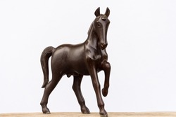 Beautiful sculpture of horse made of wood isolated on the white