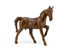 Beautiful sculpture of horse made of  wood isolated on the white background
