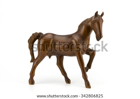 Beautiful sculpture of horse made of  wood isolated on the white background stock photo