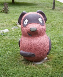 Beautiful sculpture of Winnie the Pooh in the Altai Mountains in Russia in the summer