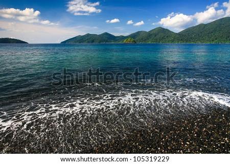Beautiful sea and black pebble beach at tropical island, Koh Lipe, Andaman sea, Thailand