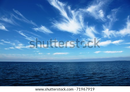 Beautiful sea and cloudy sky - stock photo