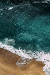 Beautiful sea background for your smartphone. Beautiful sandy beach with turquoise ocean, vertical view. Seascape from a quadrocopter. Beautiful seascape background. Sandy beach on the island.