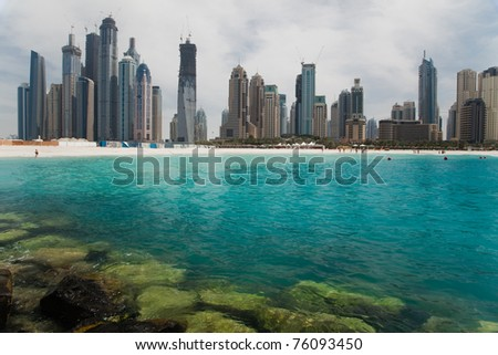 Beautiful sea bay on the background of the modern city.