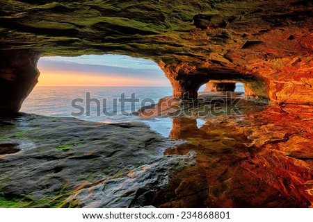 Beautiful sea cave sunset on Lake Superior near Munising, Michigan and Pictured Rocks National Lakeshore.