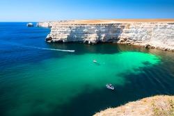Beautiful sea coast with turquoise water and rocks. Tarhankut Cape, Crimea peninsula. Summer seascape, famous travel destination
