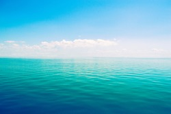 Beautiful sea horizon on a background of blue sky close up