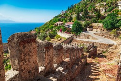 Beautiful sea landscape of Alanya Castle in Antalya district, Turkey, Asia. Famous tourist destination with high mountains. Summer bright day and sea shore