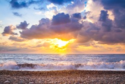 beautiful sea landscape with a sunset. evening purple sky with clouds over ocean. sea surf with waves