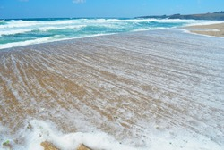 Beautiful Sea Landscape with Waves Breaking on a Sandy Beach.Waves Background