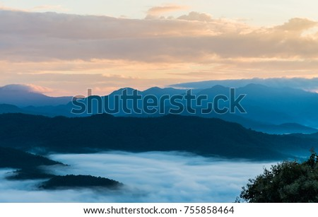 Beautiful Sea of mist in the morning with layer of mountain and sunrise scene - Shutterstock ID 755858464
