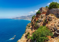 Beautiful sea panorama landscape of Alanya Castle in Antalya district, Turkey, Asia. Famous tourist destination with high mountains. Summer bright day and sea shore