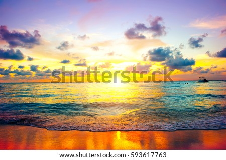 Beautiful Sea Sunset Beach. Paradise Caribbean island. Beauty Scene or sun over colorful sky with clouds. Tourism, travel, vacation concept background. Mexico. Golden Colors