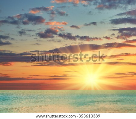 Beautiful sea sunset cloudy sky piercing rays of the sun #353613389