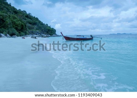 Beautiful sea view, crystal clear turquoise water, traditional Thai boat and chashing waves on the beach #1193409043