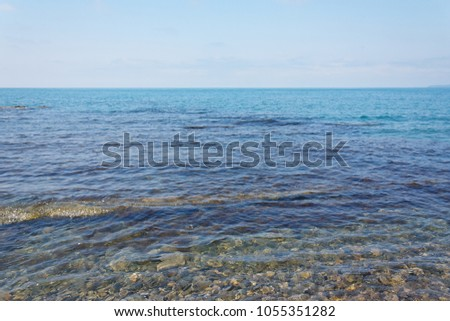 Beautiful sea view of the calm sea under a blue sky #1055351282