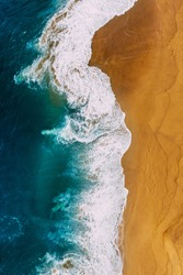 Beautiful sea wave. Clean beach with beautiful yellow sand and turquoise sea, vertical photo. Beautiful seascape, view from the height. Beautiful sandy beach, top view. The ocean and beach. Copy space