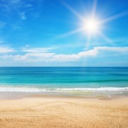 beautiful seascape and sun on blue sky background