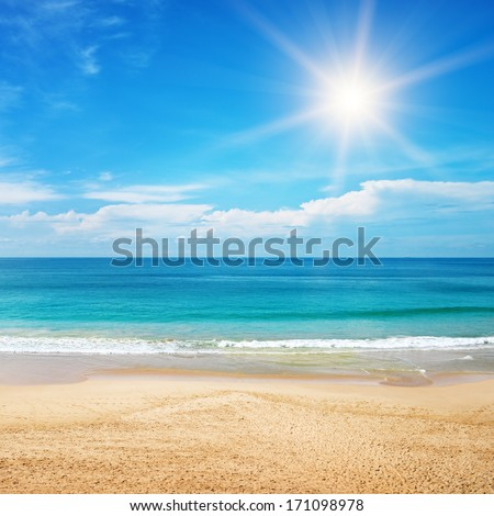 Stock Photo beautiful seascape and sun on blue sky background