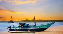 Beautiful seascape and sunset sky and the ocean. Traditional wooden fishing boats. Sri Lanka