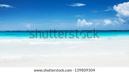 Beautiful seascape, clean turquoise sea, white sandy coastland, blue sky, exotic beach, luxury resort, summer vacation and holiday concept #139809304