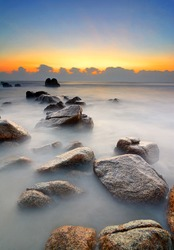 Beautiful seascape during sunrise with slowshutter
