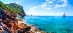 Beautiful seascape in Alanya, Turkey. Sunny summer day in turkey resort. Amazing view on rocky coastline and blue mediterranean sea with ships.