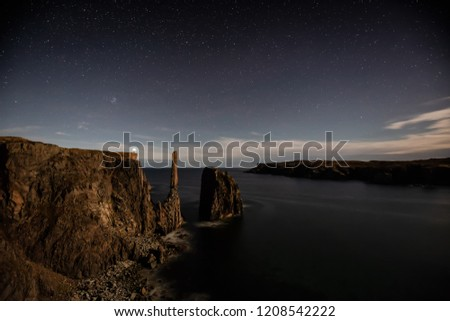 Beautiful seascape of a rocky Atlantic Ocean Coast during a clear star filled sky at night. Taken in Spillars Cove, Bonavista, Newfoundland and Labrador, Canada.