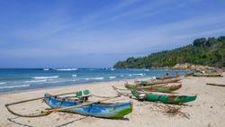 Beautiful seascape view of Wanokaka beach with colorful outrigger fishing boats, Lamboya, Sumba island, East Nusa Tenggara, Indonesia