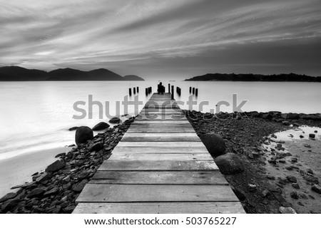Beautiful seascape view with wooden jetty at Marina Island, Lumut Perak Malaysia. Black and white photography.