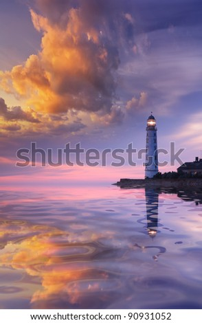Beautiful seascape with a lighthouse at sunset