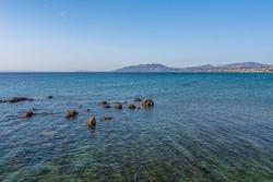 Beautiful seascape with rocks on the sea near the beach at Artemida, Athens, Greece. Greek seascape with rocky beach near Athens, Greece