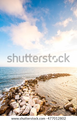Beautiful seascape with stony spit on the sunset #477012802