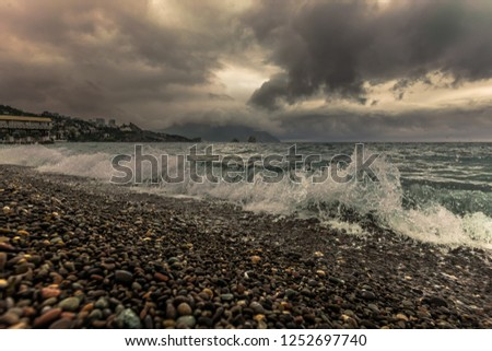 Beautiful seascape with stormy sea, grey sky and Ayu-Dag mountain in a fog. Crimea, Gurzuf.
