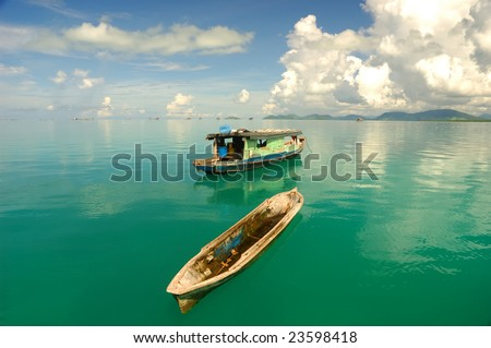 Beautiful seascape with water reflection and boat