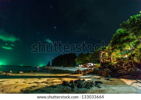 Beautiful seascapes in the night and star of Lipe Island and white sand beach. The island in andaman of thailand.\ You also see very impressive and romantic stars.